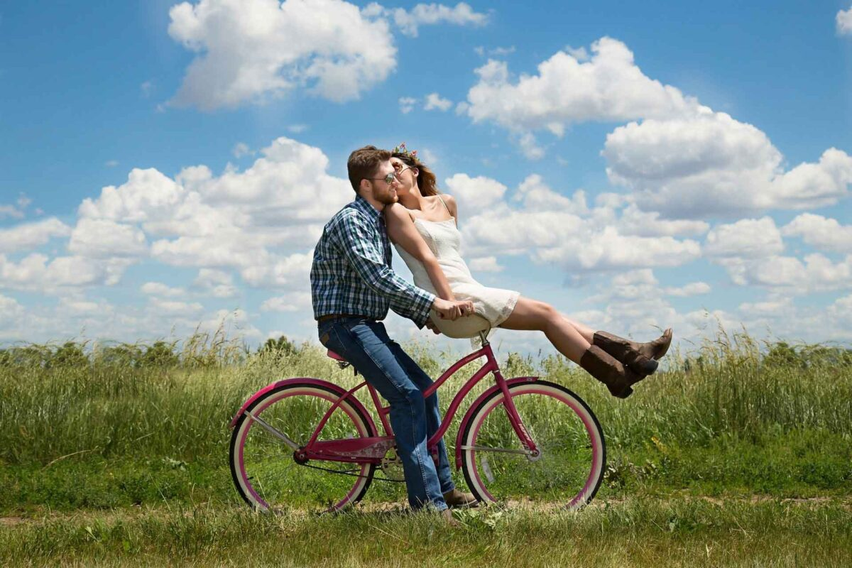 Romantic Getaways In Ontario Couple riding bike through field