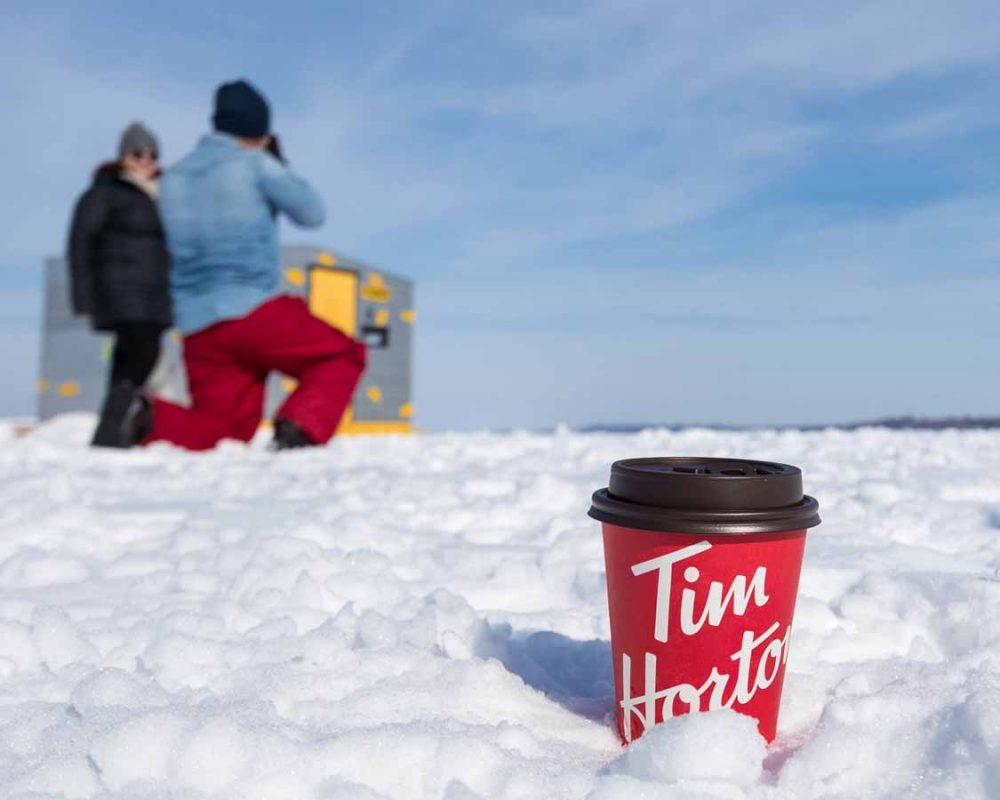 Tim Hortons Cup In Front Of Ice Fishing Hut in Durham County Ontario