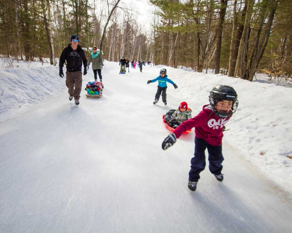 Families skating at MacGregor Provincial Park in Saugeen Shores
