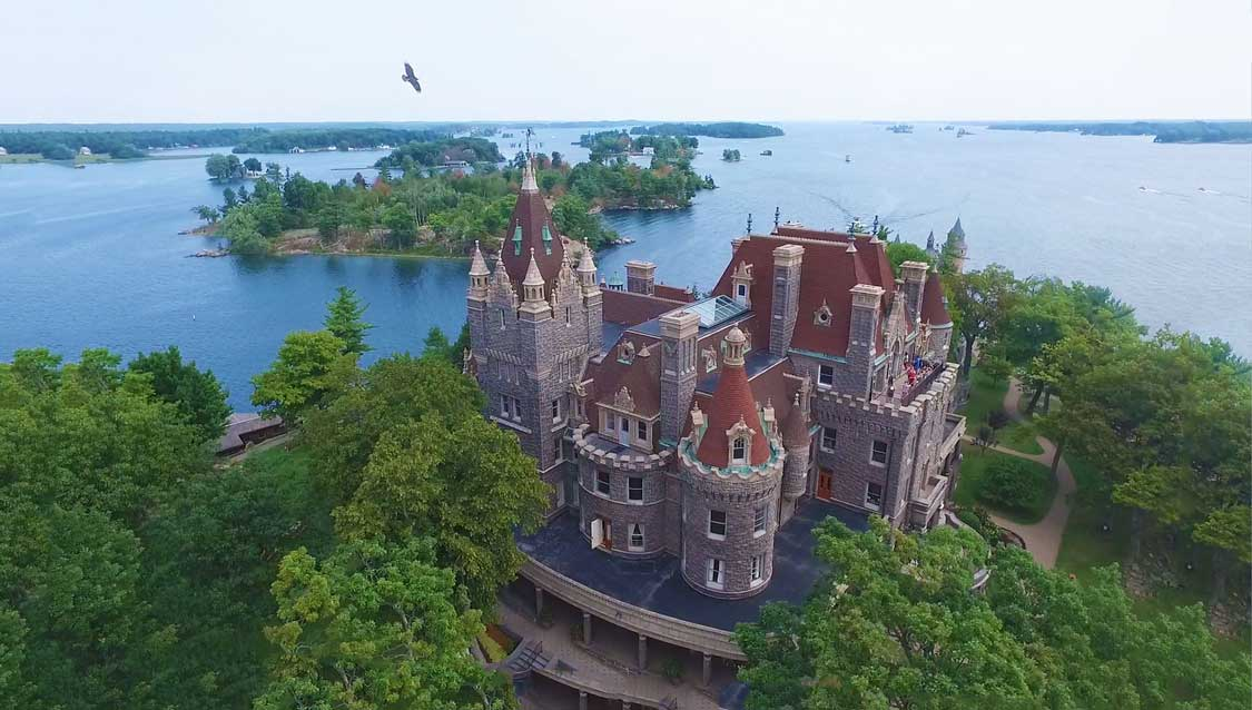 Aerial photo of a castle on an island in the St. Lawrence River
