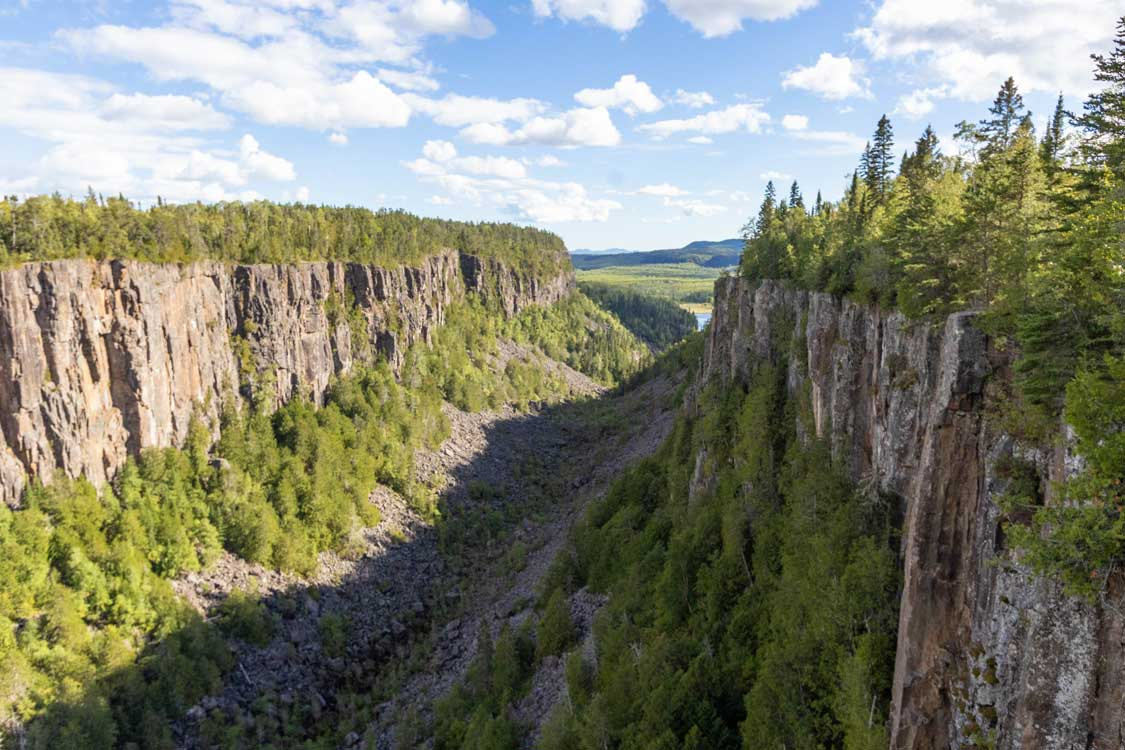 A canyon with sheer walls topped with forests in northern Ontario