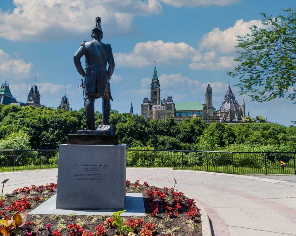 A statue overlooking the Canadian Parliament Buildings