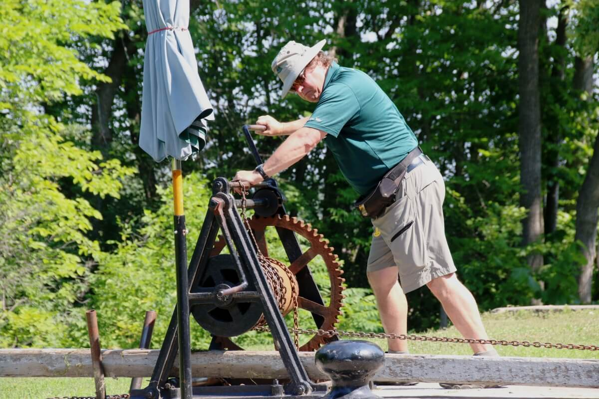 Parks Canada staff opening locks on Rideau Canal