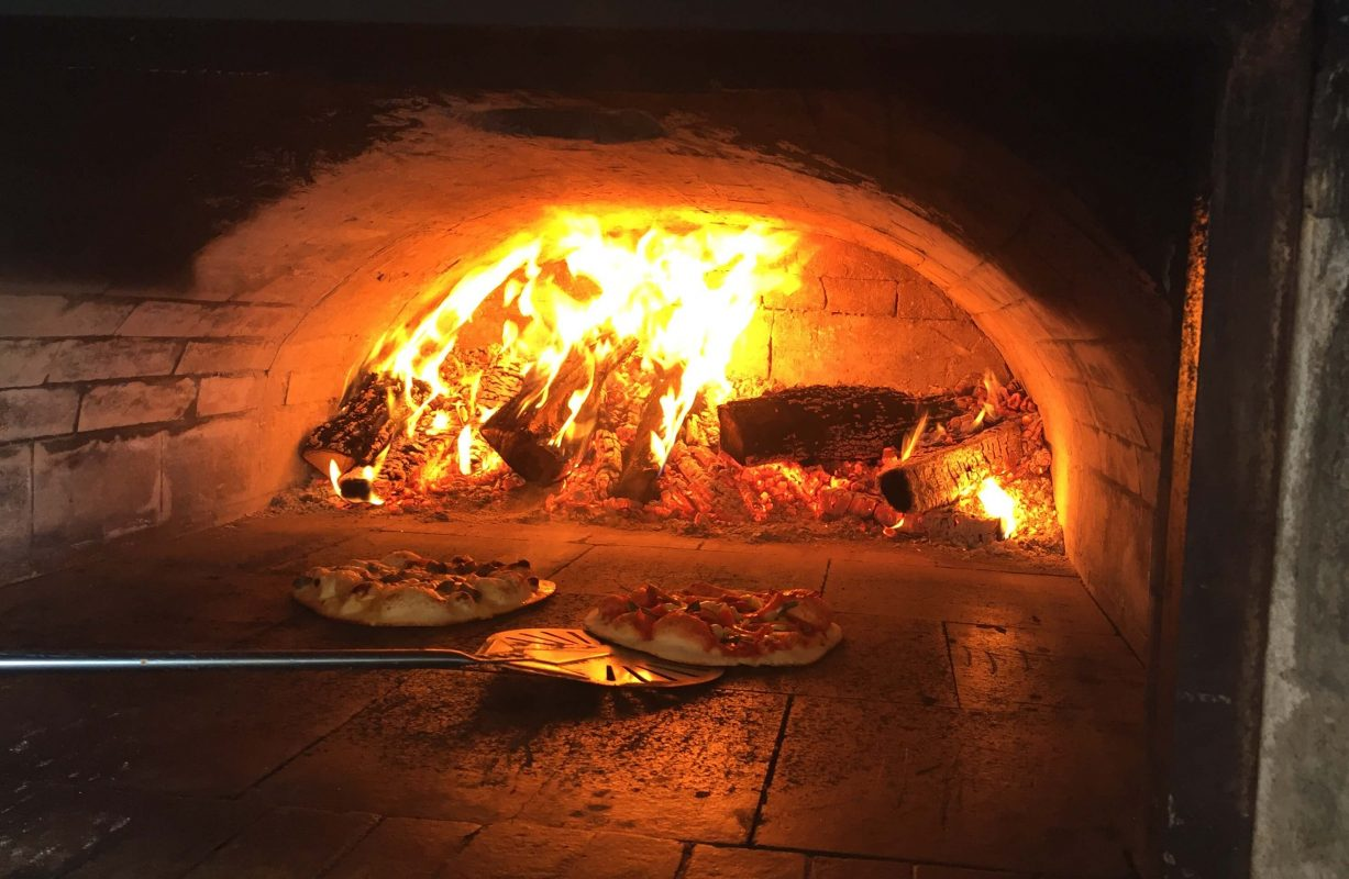 Mouth watering pizza cooking in the wood ovens at Scheuremann Vinyard & Winery