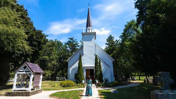A woman standing outside of the Mohawk Chapel in Brantford, Ontario