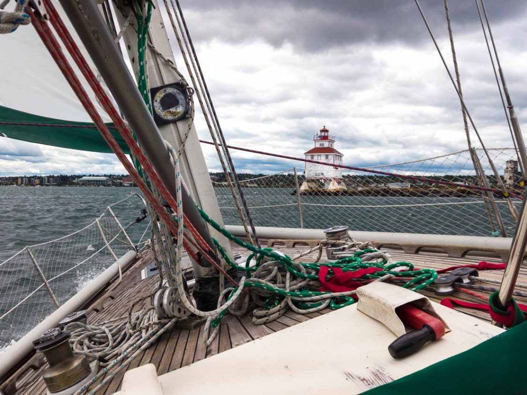 Sailboat on Lake Superior with the Thunder Bay lighthouse