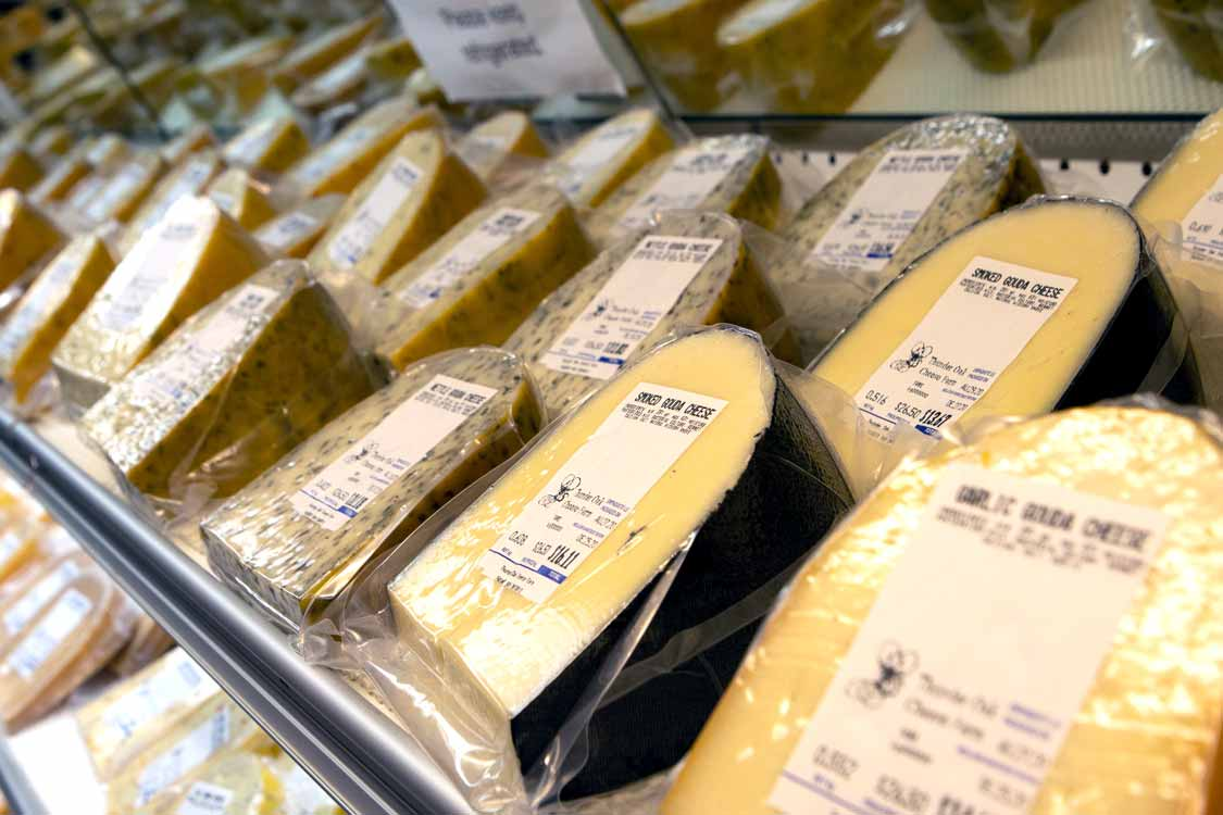 Racks of Gouda cheese at Thunder Oak cheese farm